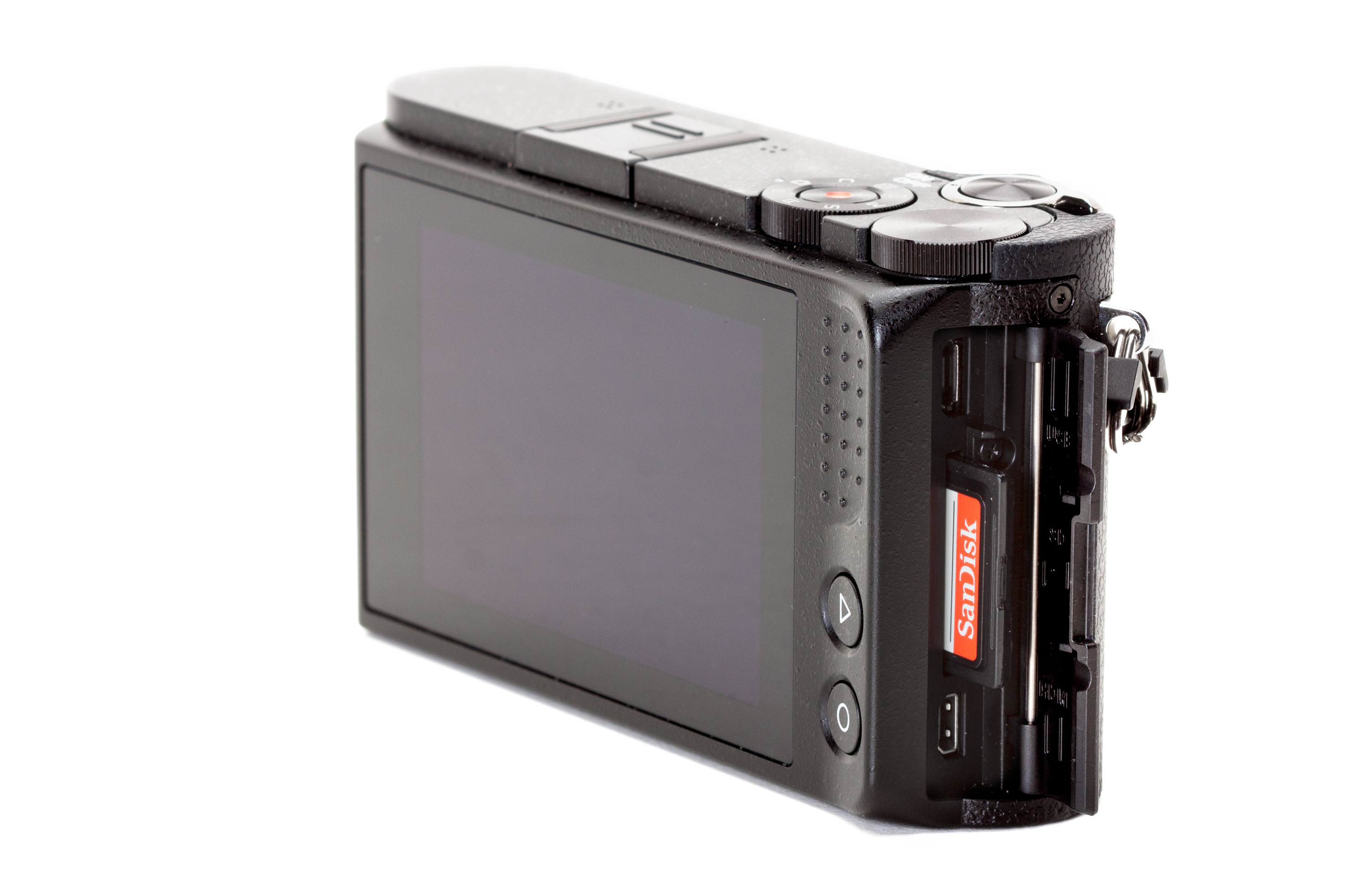 The camera's Micro-USB and Micro-HDMI ports can be accessed via the memory card slot door, and the camera utilizes SD/SDHC/SDXC format storage cards.