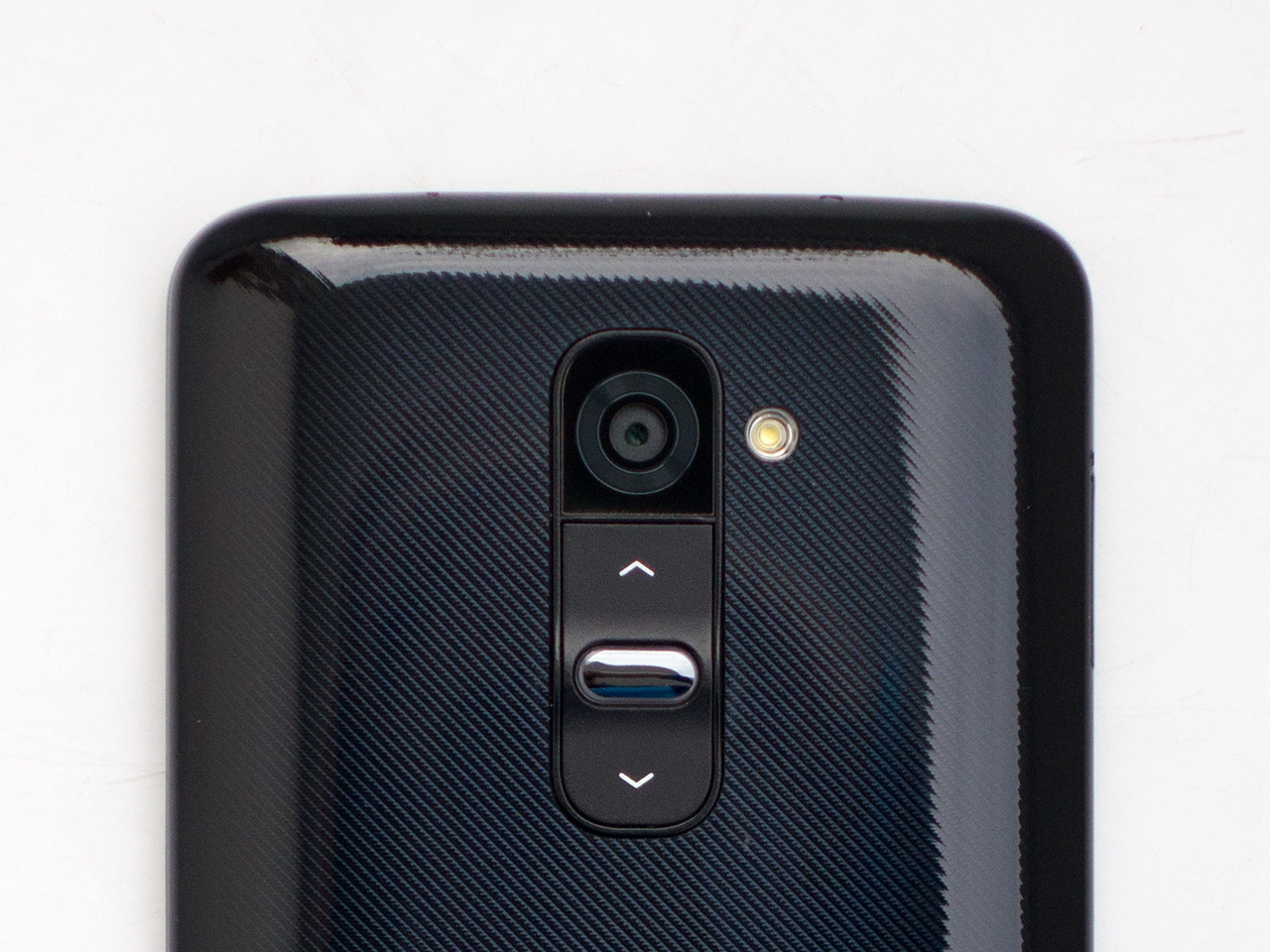 Camera Review Lgs G2 Smartphone Is First 13mp Android With Ois Lg D802 32gb White Free Flip Cover All Of The G2s Controls Power Button And Volume Rockers Can Be Found On Back Device Just Below Lens Buttons Also