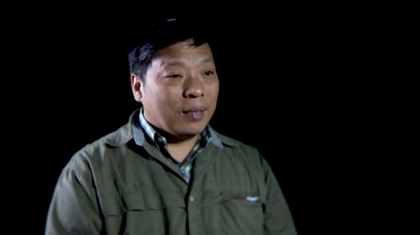 China confirms photojournalist Lu Guang's arrest near Xinjiang