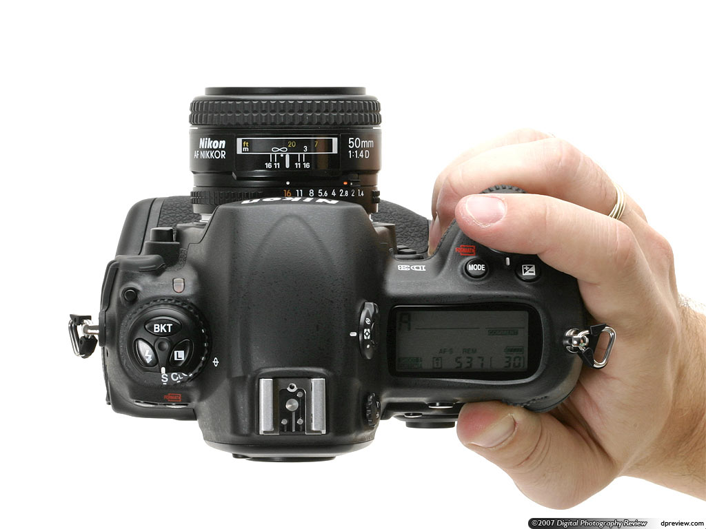 Nikon d3000 brief hands on digital photography review nikon dslr we can think of it falls well into your hand and immediately puts the key controls shutter button exposure compensation and control dial baditri Images